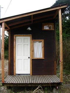 corrugated metal tiny house... shape, window/door placement, finishes ... http://tinyhouselistings.com/tiny-corrugated-cabin/