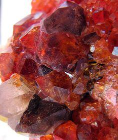 Smoky quartz and orange garnet crystal cluster.