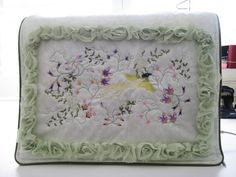 "Machine embroidery sewing machine cover using ""After the rain"" design set"