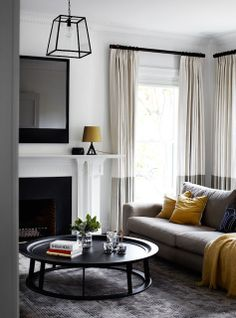 Toorak project by Robson Rak Architects White and grey Living room with fireplace