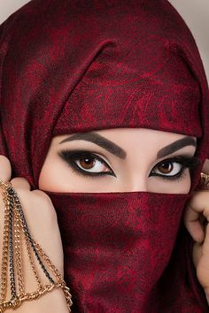 Portrait of beautiful arabian girl hiding her face behind red niqab… Portrait of beautiful arabian girl hiding her face stock photo Arabian Eyes, Arabian Makeup, Beautiful Muslim Women, Beautiful Hijab, Arabian Beauty Women, Red Dress Makeup, Muslim Beauty, Girl Hijab, Eye Photography