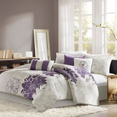 This purple floral bedding has a feminine design, perfect for a teen girl's room.  Add a delicate touch with lace-trimmed bed skirts and ruffled pillows.