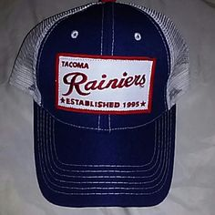 New RAINIERS promotional velcro hat Blue, white and red netted Velcro hat. Front reads Tacoma Rainier's *ESTABLISHED 1995*. Very cool hat Accessories Hats