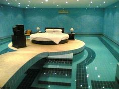 Swimming Pool Bedroom | Seriously, who needs this?! What if you accidentally roll off the bed while you're sleeping? What if you sleep walk? Safety hazard.