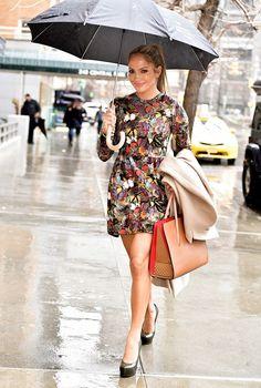 Jennifer Lopez braved the rain in platform stilettos, Valentino's butterfly-printed dress, and a Christian Louboutin bag.