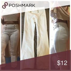 White stretch pants. Gold buttons on front. No zipper. Stretches. Worn once. Like new. Small flare at bottom. NOT SKINNY PANTS. MODEL 5'9. Size fits 10-12 Pants