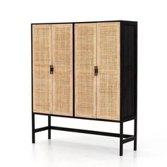 Two-tone contrast with a textural twist. Washed black acacia forms spacious open shelving, while natural cane weaves to cover four mango-framed doors. A simple Parsons-style base and black iron hardware pulls add eye-catching contrast to modern cabinetry. Door Storage, Kitchen Storage, Storage Cabinets, Display Cabinets, Diy Kleidung Upcycling, Armoires Diy, Dining Cabinet, Cabinet Doors, Cabinets For Sale