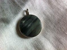 Silver pendant with greenish grey stone. Lennart Oehmke, Stockholm, Sweden, 1964.