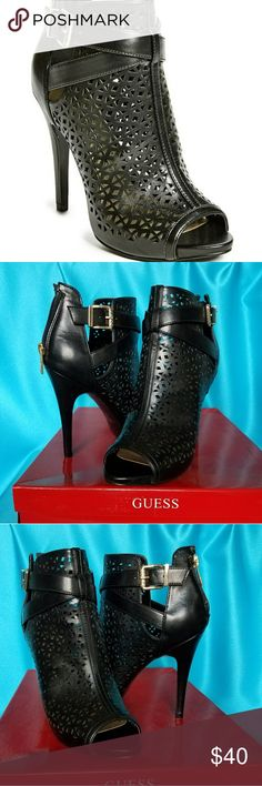 """GUESS Booties Guess Cosma Booties   Featuring a crisscross strap and flattering side cutouts, these perforated booties pair perfectly with any day or night look. Finished with a peep toe and an adjustable ankle strap with buckle closure.  •4.5"""" heel  • Material: Synthetic  • Gold Metallic Logo Harware on Zipper  ** Worn Once ***NO TRADES***  PICTURES WERE TAKEN IN NATURAL SUNLIGHT 😎 Guess Shoes Ankle Boots & Booties"""