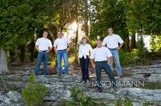 Door County Family Portraits with three adult children. Outdoor at Cave Point, Lake Michigan // Jason Mann Photography, 920-246-8106, www.JMannPhoto.com