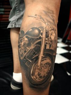 This badass chopper was inked by Miguel Ángel Bohigues. #inked #Inkedmag #tattoo #motorcycle #chopper #biker #realism #art #ink #idea