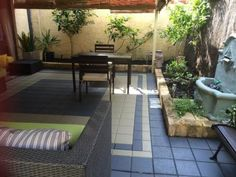 Paving and slightly raised garden beds