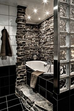 Bathtub idea...would love it even more if there was a shower head in the middle and the black tiles were rock