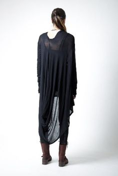 A long asymmetric tunic with extra long sleeves and unique draping on the back. Feel beautiful and empowered wearing it with your favorite leggings