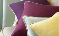 Piped linen cushions - would be lovely if piped in a bright velvet fabric
