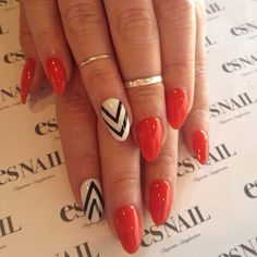 Red nails with black and white chevron accent