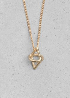 & Other Stories   Lykke Li. A pendant featuring an intriguing shape inspired by secret signs and symbols connected to the nomad theme of the collection.