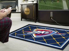 This OKC All Star rug is for the all star fan such as yourself.  Thick and comfy, it'll transform any living room.  Free shipping too!