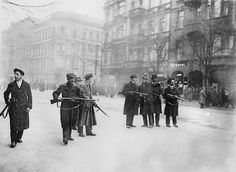 A line of armed revolutionaries in a Berlin street during the German Revolution of 1918 - 1919.