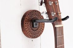 Etch wood guitar hanger of mandala design and hand forged steel holder Ukulele Wall Mount, Guitar Wall Hanger, Mandala Design, Concrete Block Walls, Ukelele, Guitar Gifts, Support Mural, Forged Steel, Guitar Design