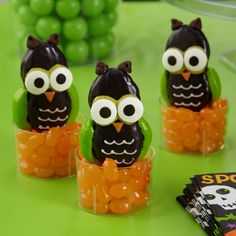 "Perch your too-cute-to-spook cookies in mini ""beak""-ers filled with orange jelly beans for an extra sweet Halloween display! @partycity"