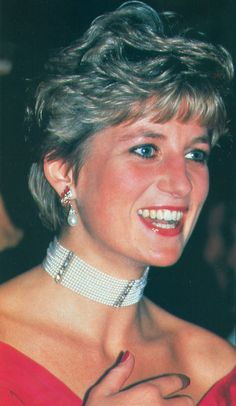 Diana wore this eleven-strand pearl choker with diamond and ruby spacers along with her ruby diamond and pearl drop earrings.