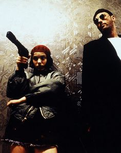 LOVE this movie!   Léon: The Professional Jean Reno as Leone Natalie Portman as Mathilda