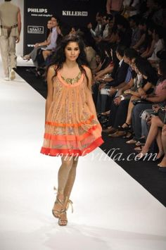 Love the dress. Gets more western every fashion show.