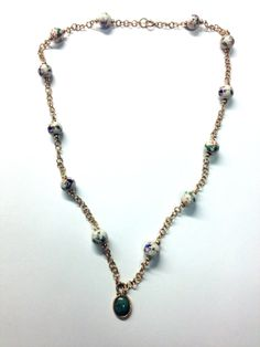 """Beautiful Gold Filled jump ring necklace with painted ceramic beads and a gemstone center Necklace is 18"""" Beads 8mm Jumprings 4mm gem 12mmx10mm"""