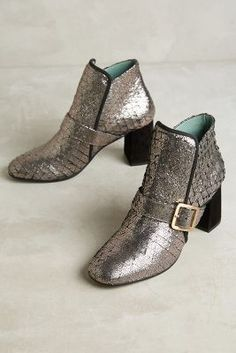 Anthropologie Paola d'Arcano Scaled Leather Booties https://www.anthropologie.com/shop/paola-darcano-scaled-leather-booties?cm_mmc=userselection-_-product-_-share-_-39919071