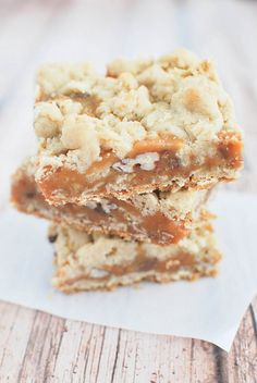 Oatmeal Carmelita Bars - gooey caramel between oatmeal cookie dough.