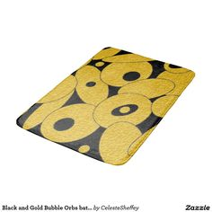 Black and Gold Bubble Orbs bath mat with matching shower curtain.