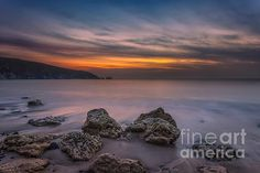 Sunset at Alum Bay on a misty evening captured with a long exposure to smooth the water