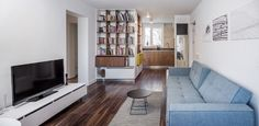 Located in Bucharest, this compact 1-bedroom apartment makes the most of its 55 square meter floor plan with smart organization and unique layout choices – al