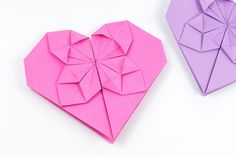 Learn how to make an origami heart using paper or a dollar bill. These easy to make paper hearts are great to use as Valentine's Day cards!