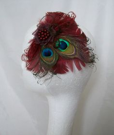 Burgundy Marsala Peacock Feather Hair Clip  by  Order Now from Gothic Diva Designs Specialising in Fabulous Elegant Gothic, Victorian Vintage & Steampunk inspired wedding designs,  Including mini hat fascinators, formal hats, feathered hair clips, ostrich
