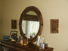Wall sconces made of old lobster traps. Notice the valance in the reflection in the mirror. Also made of lobster trap wood.