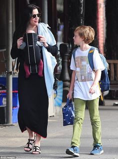Her favourite boys! The actress was seen with baby Sailor and 10-year-old son Milo in New ...