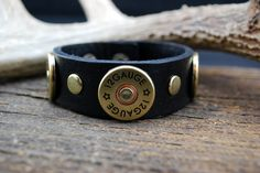 Very cool leather bracelet with three 12 gauge shotgun shell concho. It is 1 wide and can is adjustable to fit either a 71/4 or 8 wrist.  All of our jewelry is safe for wear and contain no powder. Each items comes beautifully packaged. Made in the USA. Bluegrass Brass Designs supports our Veterans and a portion of the sale of this item will be donated to Wounded Warriors.