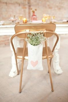 blush and gold -- any type bag would work here.....greenery or wildflower cuttings would make a nice, but inexpensive, no skill required, chair decor.
