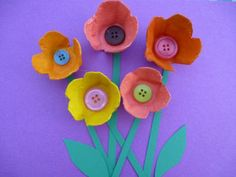Made from sections of an egg box, painted in bright colours. Add buttons and green cardboard leaves.