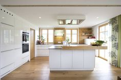 Kitchen glossy white with old wood: kitchen by atelier for kitchens & home decor laserer - White Kitchen Remodel Kitchen Remodel, Kitchen Decor, Modern Kitchen, New Kitchen, Studio Kitchen, Home Kitchens, Kitchen Layout, Classic Kitchens, Kitchen Sets