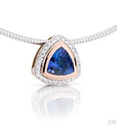 Daniel Moesker 18kt Rose and white gold pendant set with a Tanzanite surrounded by diamonds.