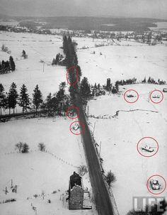 """An arial photo from the Battle of The Bulge. Four Panthers from the 4th SS-PzRgt 2 """"Das Reich"""" were immobilized in a minefield (Rt), and three more were knocked out near the main road. Battle of the Bulge in the Ardennes region, Pic 2 of 3."""