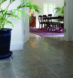 Olivier Limestone in a tumbled finish. Dark limestone tiles that look great when paired with natural wood furniture.