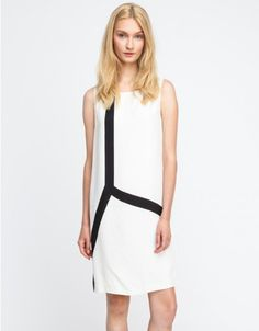 A sleeveless, lightweight shift dress from Won Hundred with a minimal geometric print pattern at the front. Features a low-cut back with strap across the shoulders, easy fit through the torso, and a full slip lining.   •Sleeveless shift dress •Geom
