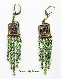 Gene Geny | Bronze color fittings and charms, Green colored crystals.