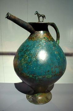 Celts - spouted bronze flagon. Waldealgesheim, Germany. About 320 BC. This flagon had been a heirloom before placing in the grave. Its surface were decorated in a somewhat earlier style. The zone consisting of regular arrangements of individual motifs were characteristic of this early style.