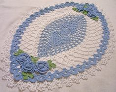 crocheted oval doily delf blue and white  by isabellestreasures