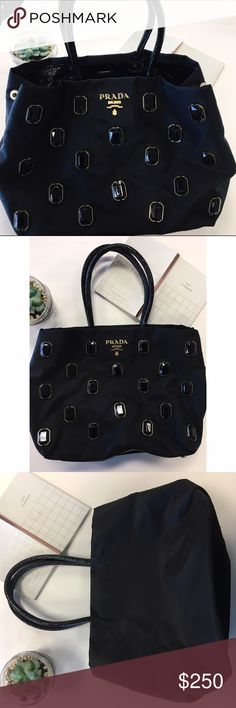 Prada jeweled handbag Authentic Prada handbag! Nylon bag with gold and black embellishments. No obvious signs of wear, even the inside is in perfect condition! Prada Bags